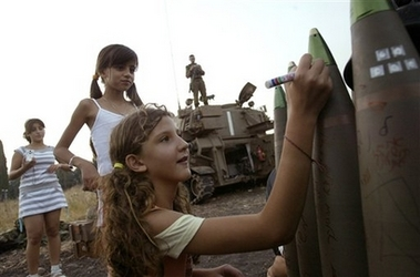 Israeli girls write messages on a shell